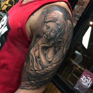 tatuaje realista ángel
