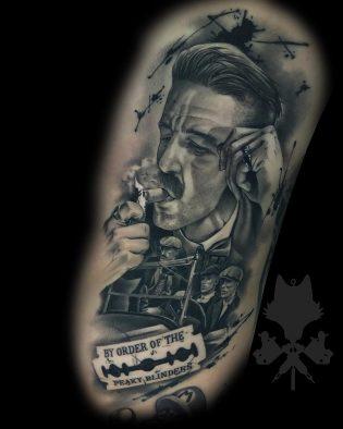 Tatuaje retrato de hombre en realismo.