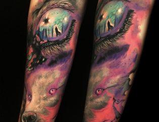 Tatuaje lobo a color en Obsession Tattoo.